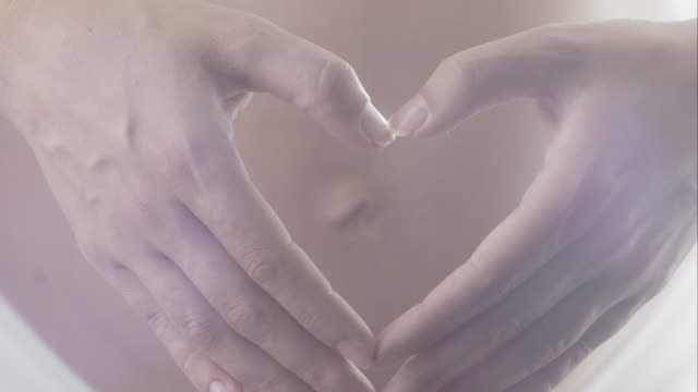 Pregnancy - Woman Belly With Heart Shape Hands video