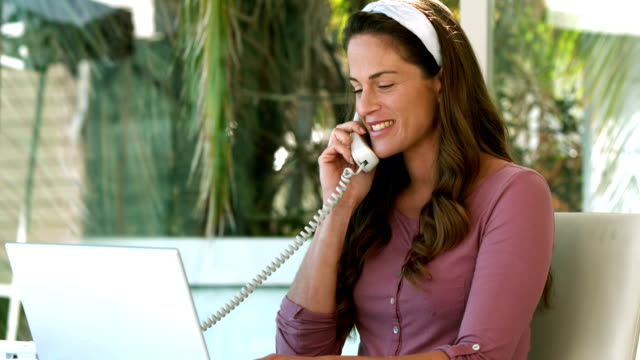 Pregnant businesswoman on the phone Pregnant businesswoman on the phone in slow motion landline phone stock videos & royalty-free footage
