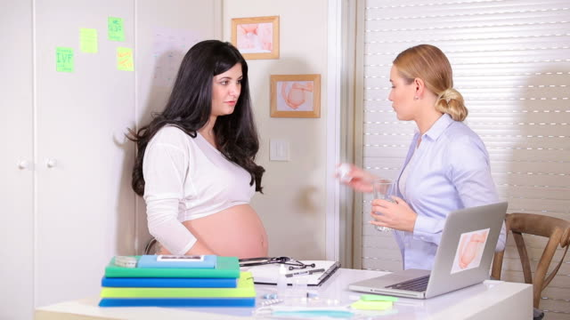 Pregnant girl at the doctor. Full HD Video video