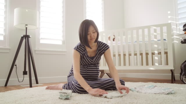 Pregnant Japanese Woman in a Nursery - video