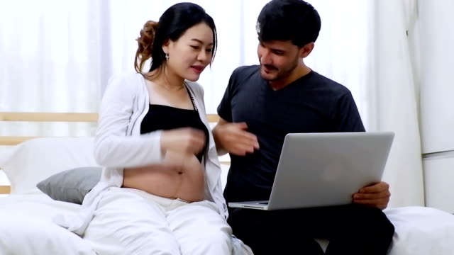 Pregnant to family over internet using digital computer. video