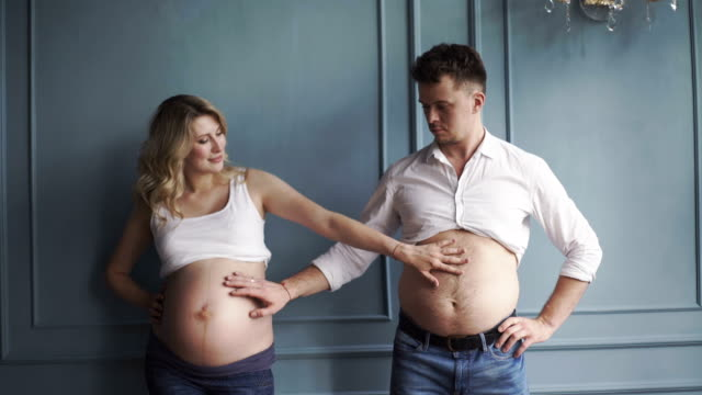 Pregnant woman and pregnant man video
