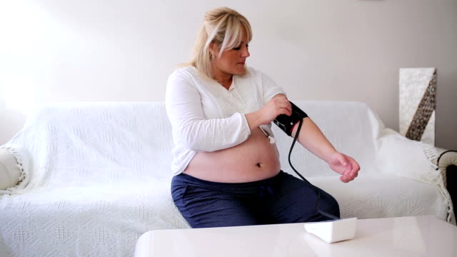 Pregnant woman checking blood pressure video