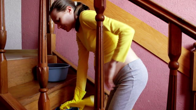pregnant woman cleans the apartment video