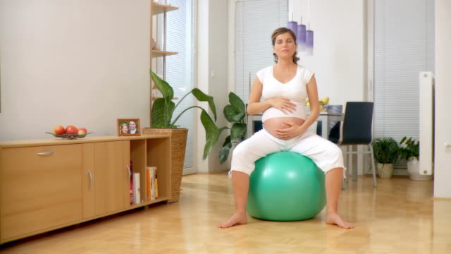 HD DOLLY: Pregnant Woman Exercising video