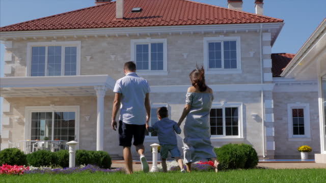 Pregnant Woman. family walks around the countryside husband, pregnant wife and little son go hand in hand. three persons. in the background of a country house mansion stock videos & royalty-free footage