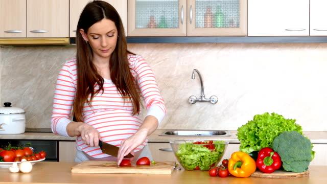 Pregnant woman making a salad video