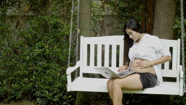 Pregnant woman using laptop video