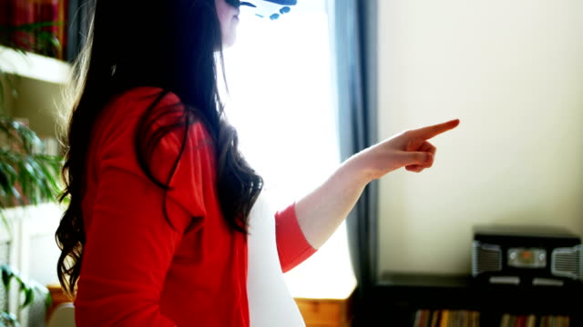 Pregnant woman using virtual reality headset video