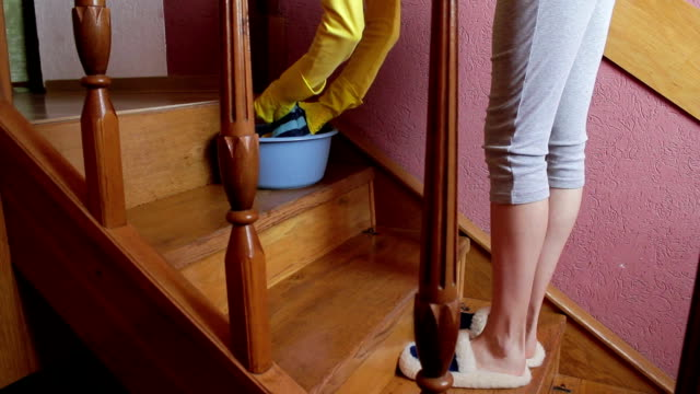 Pregnant woman washes the stairs video