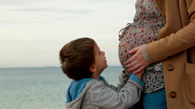 Pregnant Woman With Little Son video