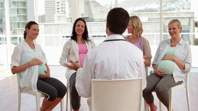 Pregnant women talking together at antenatal class video