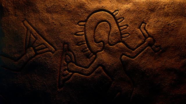 Prehistoric Alien Carving Is Lit Up