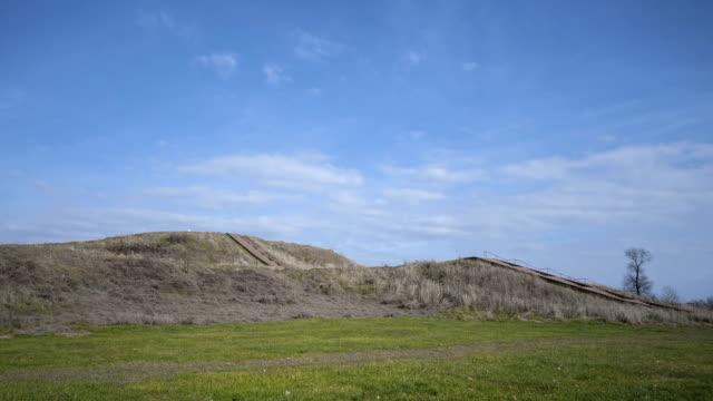 Pre-historic Cahokia Mounds Time lapse of People walking up the prehistoric Monks Mound of Cahokia, IL heap stock videos & royalty-free footage