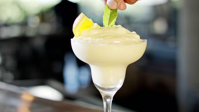 preparation of a cup of Margarita preparation of a cup of Margarita in slow motion margarita stock videos & royalty-free footage