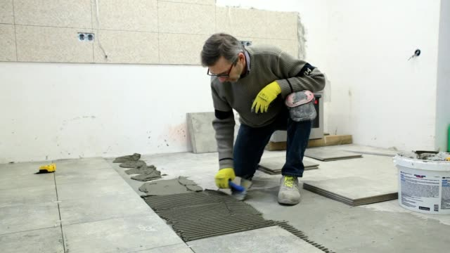 Preparation of building glue for installation of tile. video