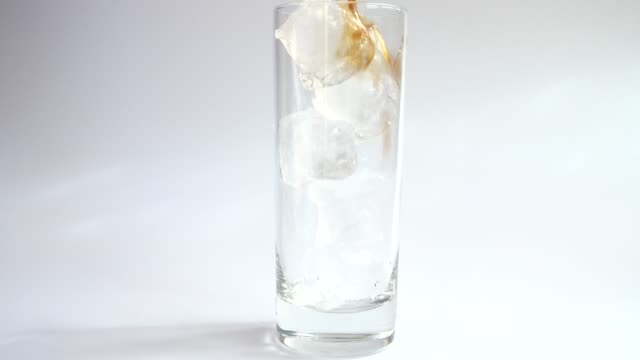 Preparation of cold coffee with milk and ice. video