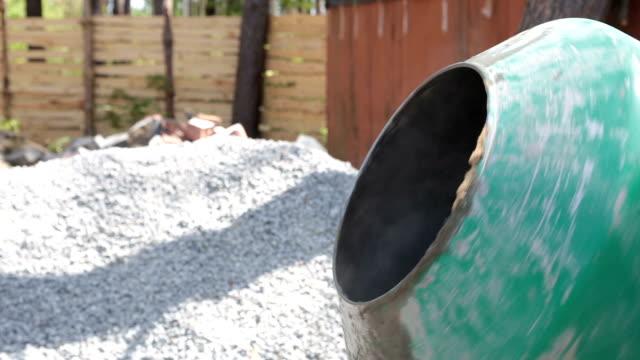 Preparation of concrete in a concrete mixer. video