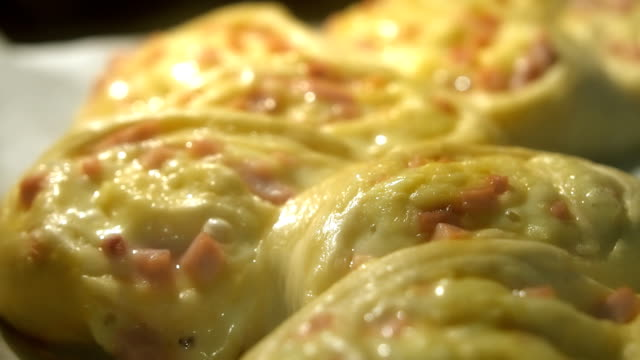 Preparation of pie with ham and cheese. Fast motion. video