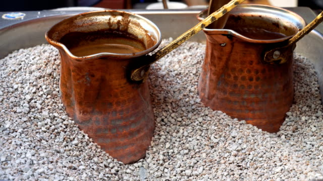 Preparation of Turkish coffee on hot sand