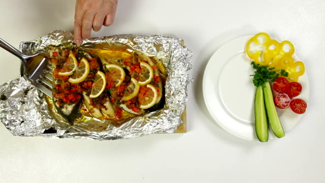 prepared baked fish - aluminum foil stock videos & royalty-free footage