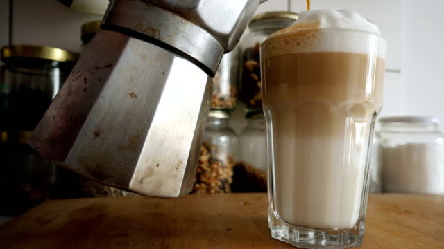 Preparing a latte macchiato in a home kitchen
