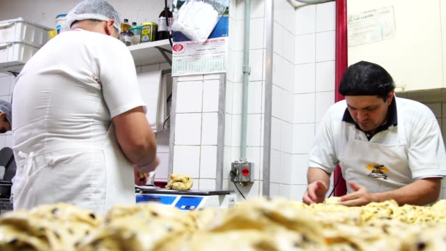preparing a panettone on the bakery - panettone video stock e b–roll