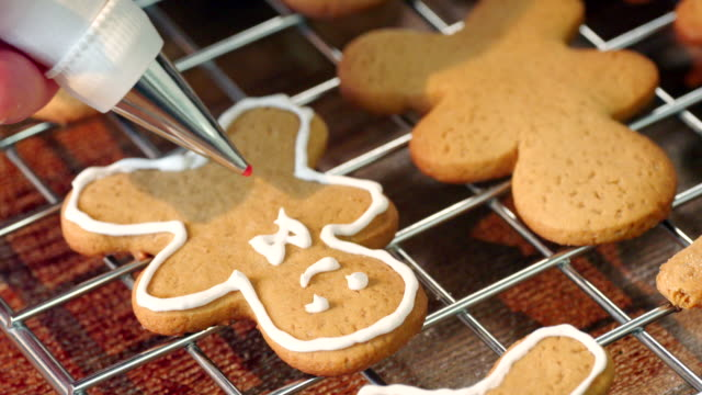 Preparing and Decorating Gingerbread Christmas Cookies Preparing and decorating gingerbread Christmas Cookies in domestic kitchen gingerbread man stock videos & royalty-free footage
