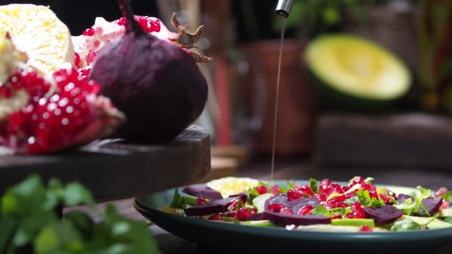 Preparing beet and orange salad