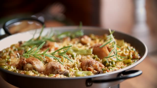 preparing chicken paella with green beans, peas and paprika - spanish food stock videos and b-roll footage