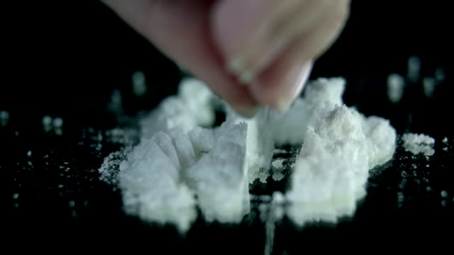 HD SLOW: Preparing cocaine for sniffing on the black backgrond video