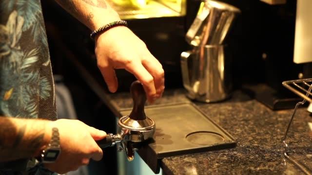 preparing coffee with coffee machine spoon - icona posate video stock e b–roll