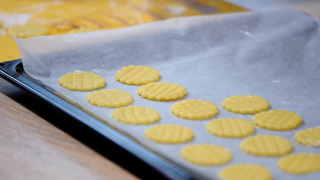 preparing cookies for baking. the process of working in the kitchen. - formare pane video stock e b–roll