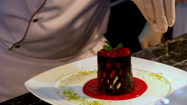 preparing dessert plate - desserts stock videos and b-roll footage