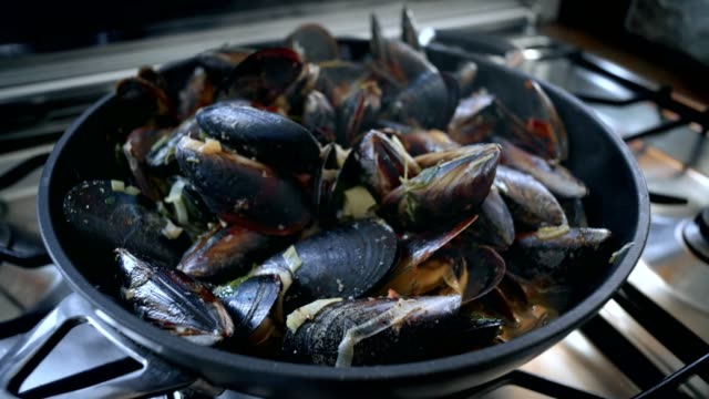 Preparing dish with seafood tasty mussels video