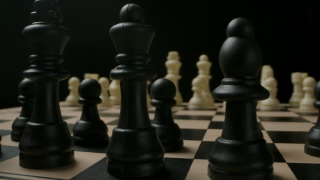Preparing for battle between black and white chess pieces. The beginning of the game