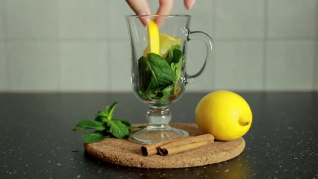 Preparing healthy green tea with mint and cinnamon video