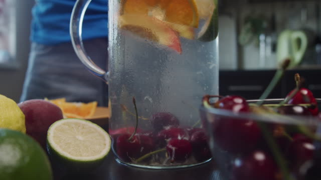 Preparing homemade fruit lemonade