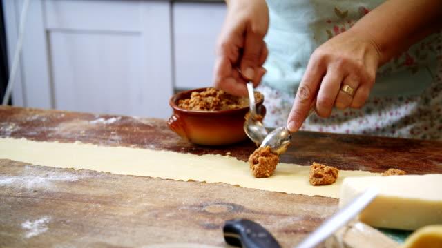Preparing Homemade Ravioli Pasta Preparing Homemade Ravioli Pasta in Domestic Kitchen ravioli stock videos & royalty-free footage