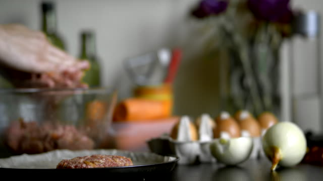 Preparing homemade roasted nests of minced meat and eggs Preparing homemade roasted nests of minced meat and eggs. Step by step. Placing onto a roasting pan ground beef stock videos & royalty-free footage