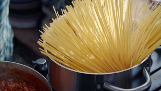 Preparing Homemade Spaghetti Bolognese Preparing Homemade Spaghetti Bolognese - Slow Motion Video spaghetti stock videos & royalty-free footage