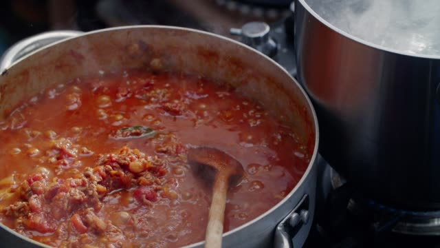 preparing homemade spaghetti bolognese - italian food stock videos & royalty-free footage