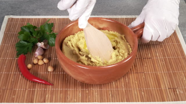Preparing Hummus with Olive Oil