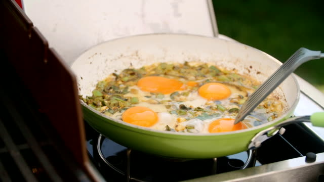 preparing indian masala fried egg - indian food stock videos and b-roll footage