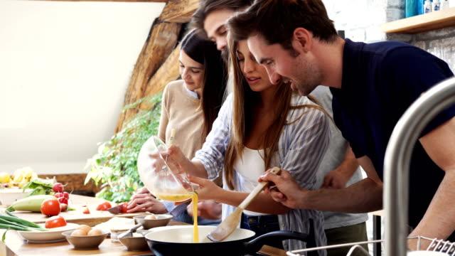 preparing omelet with friends - приготовление еды стоковые видео и кадры b-roll