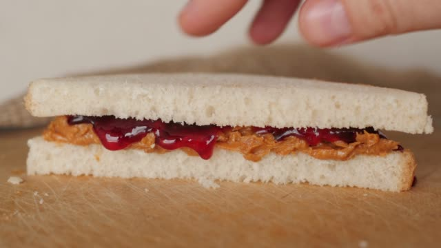 preparing peanut butter and jelly, jam sandwich, pressing bread preparing peanut butter and jelly, jam sandwich, pressing bread jello stock videos & royalty-free footage