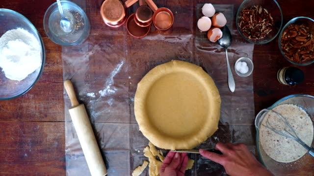 Preparing Pecan Pie for the Holidays Preparing Homemade Pecan Pie for the Holidays pastry dough stock videos & royalty-free footage