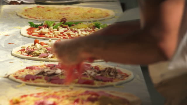 preparing pizzas close-up - pizza stock videos and b-roll footage