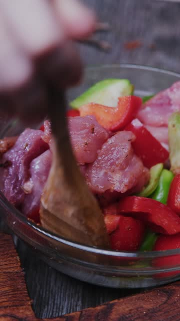 Preparing pork skewers marinated with bell pepper video