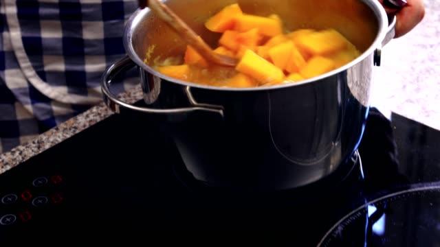 preparing pumpkin soup at home - pumpkin стоковые видео и кадры b-roll
